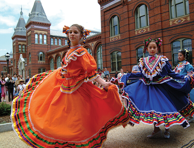 performers dancing in the courtyard